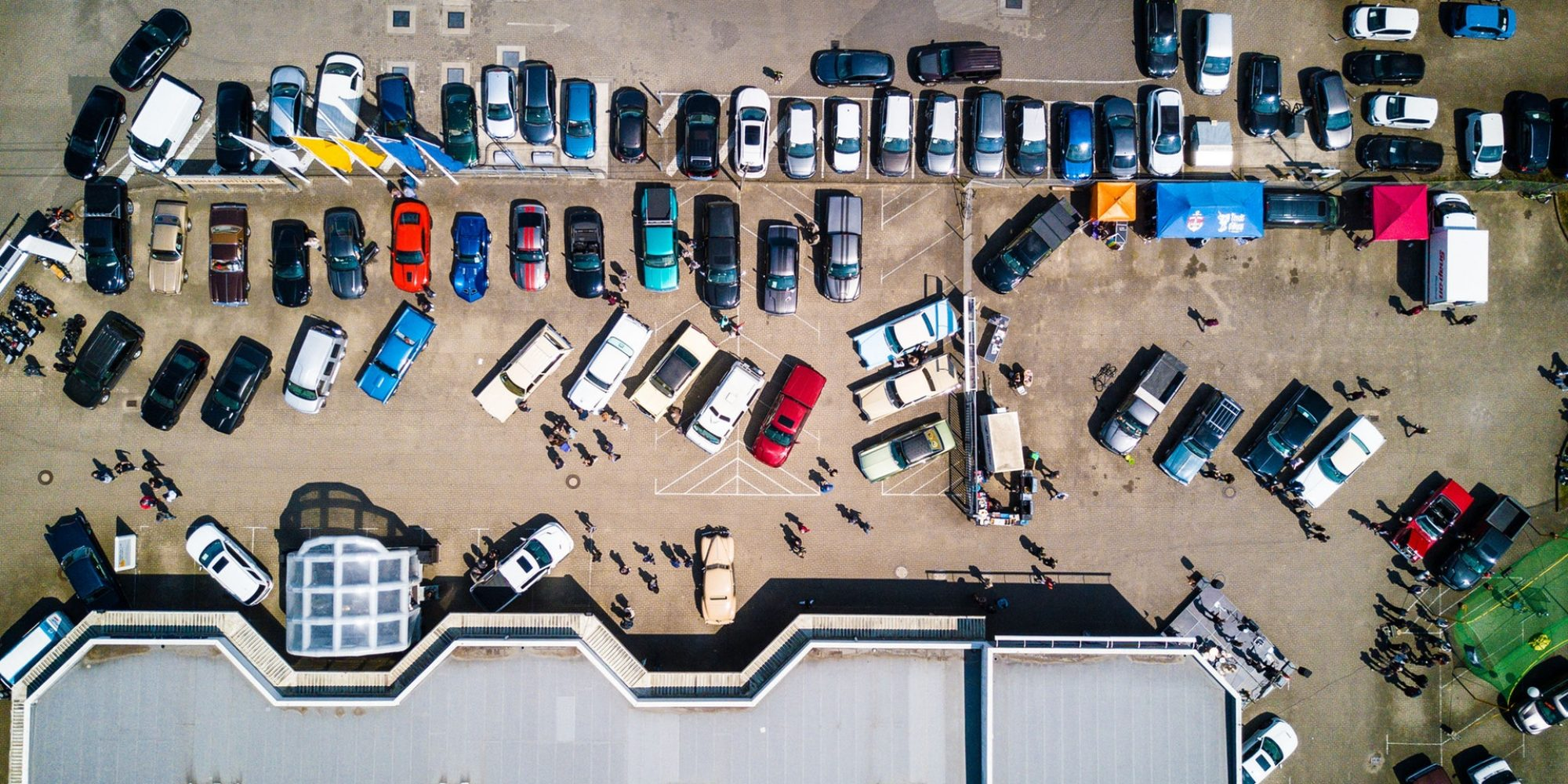 photo-from-above-of-vehicles-parked-near-building-753876 (1)